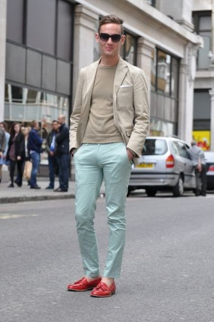 With beige shirt, beige jacket and red shoes