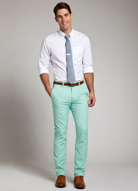 With white button down shirt, printed tie and brown shoes