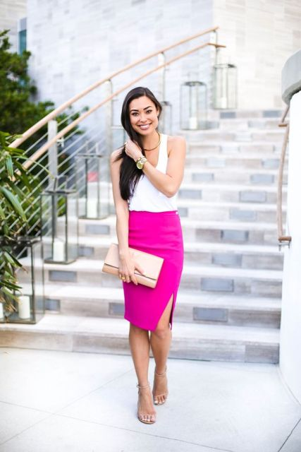With white top, sandals and beige clutch