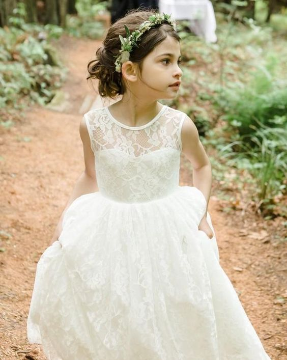 an ivory lace dress with an illusion neckline and a greenery crown