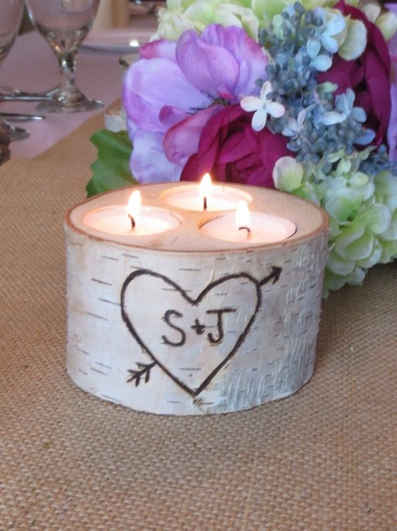 a birch bark log with candles for table decor