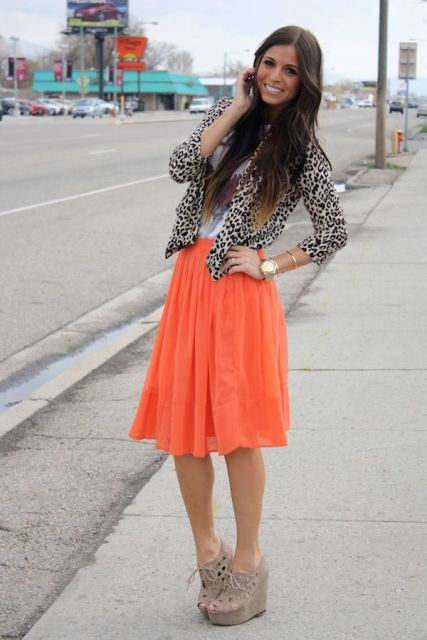 With white shirt, animal printed jacket and platform shoes