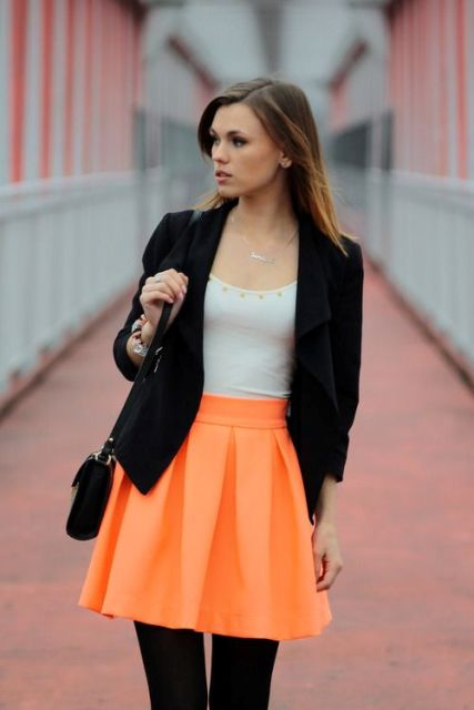 With white top, black blazer, black tights and small bag