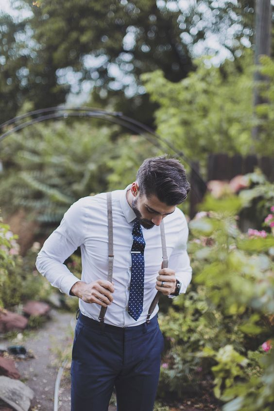 navy pants, a white shirt, grey suspenders and a navy polka dot tie