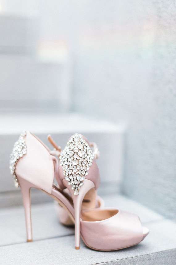 Glam pink shoes with rhinestones polished her look