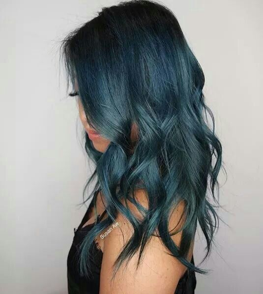medium length hair of teal color with light waves