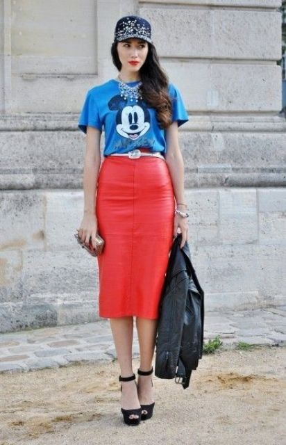 With funny t-shirt, platform shoes, leather jacket and cap