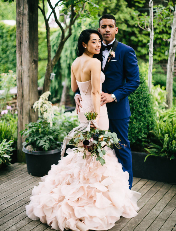 The groom was rocking a chic blue tuxedo with black details, very elegant