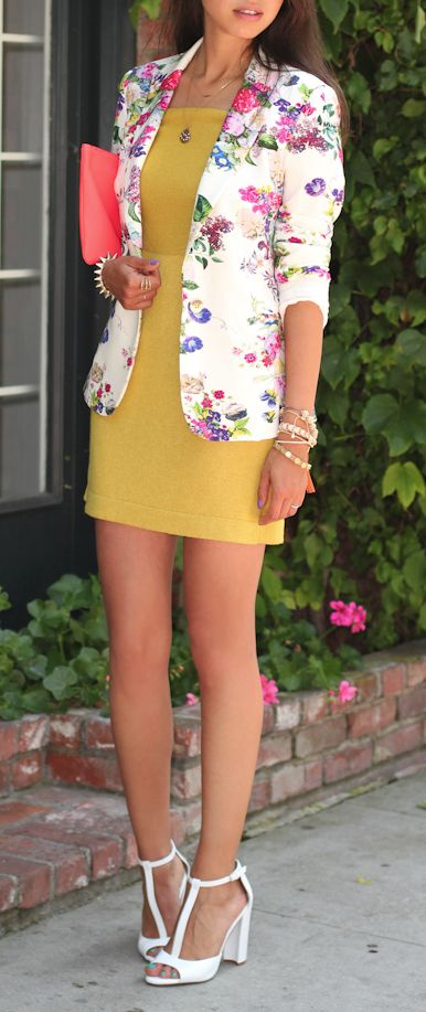 a yellow mini dress, a bold floral blazer and white heels