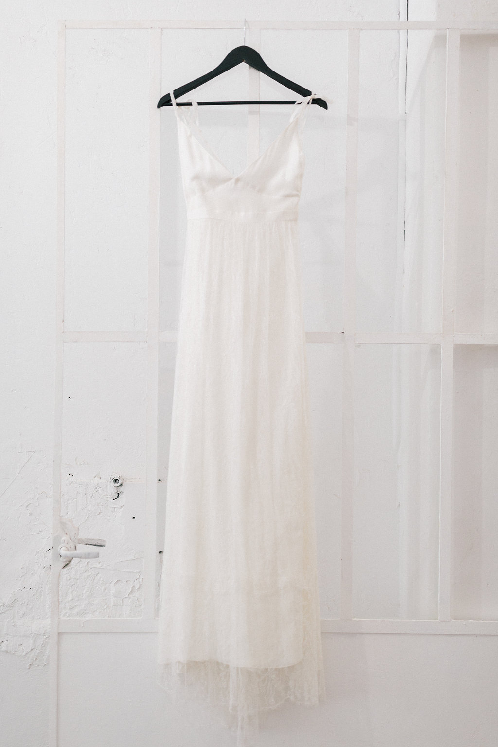 white wedding dresses - photo by Julien Bonjour Photographe http://ruffledblog.com/airy-industrial-wedding-inspiration-for-spring
