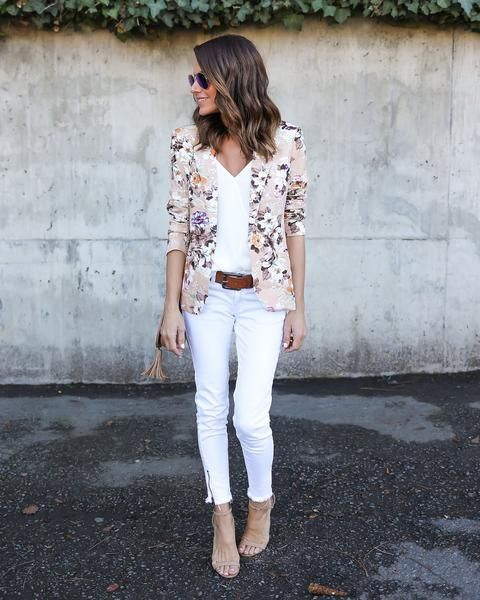 white pants, a white top, a delicate floral blazer and nude heels