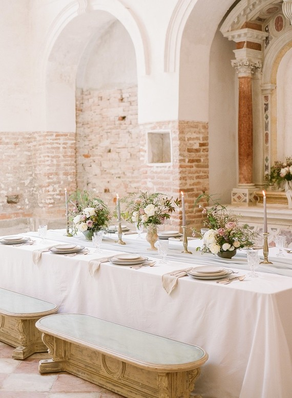 The wedding tablescape was done in pastels, with a blush tablecloth and pastel florals