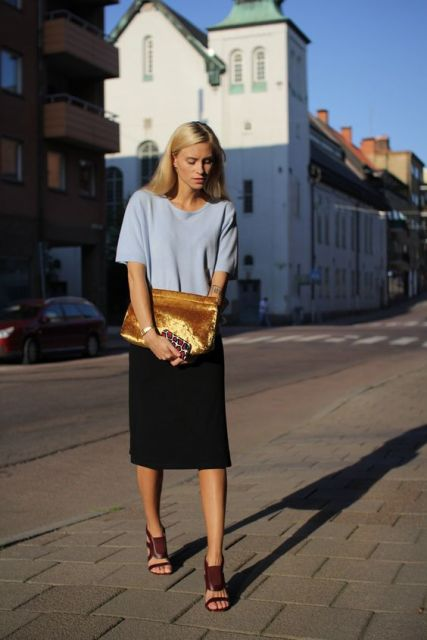 With light gray shirt, black knee-length skirt and marsala shoes