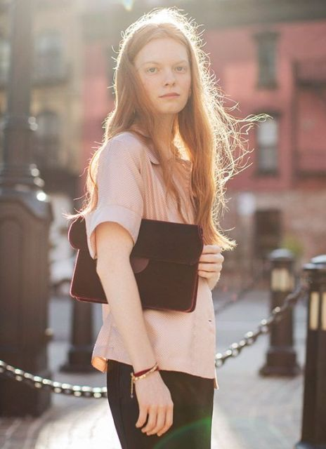 With pale pink blouse and black skirt