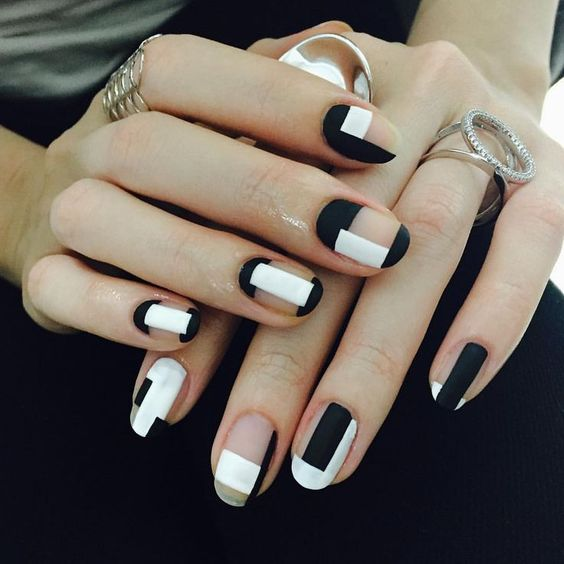matte black and white negative space geometric nails
