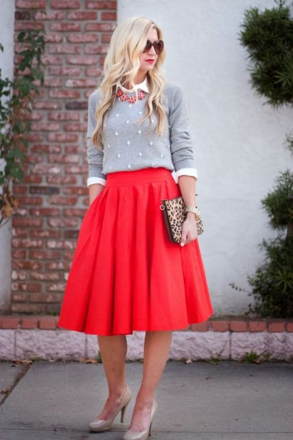 With white shirt, gray sweatshirt, leopard clutch and beige shoes