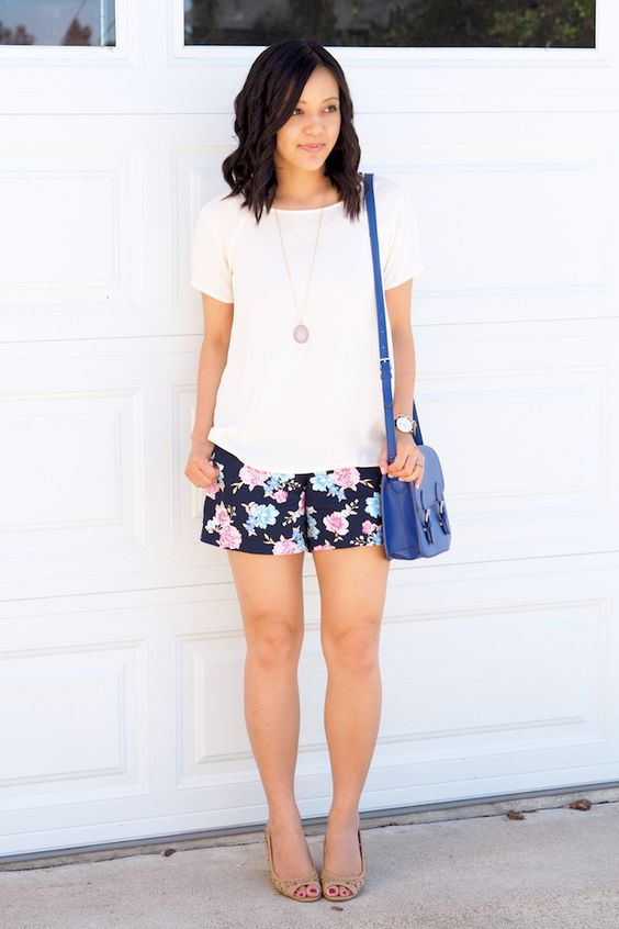 14 a white tee, black floral shorts and nude peep toe heels