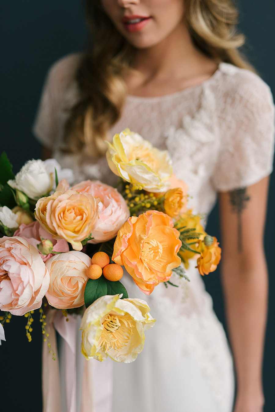 poppy paper flowers - photo by Ashlee Brooke Photography http://ruffledblog.com/summertime-citrus-wedding-inspiration