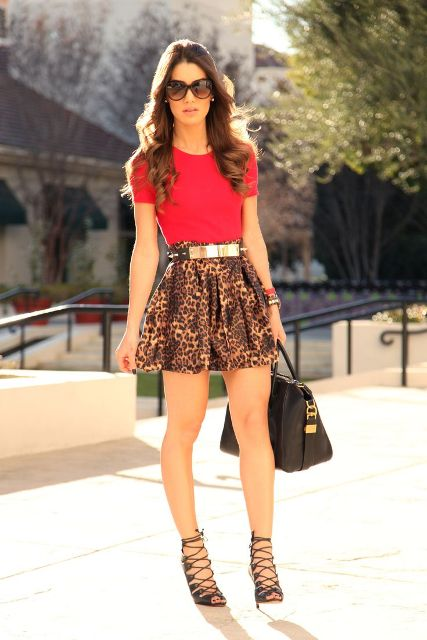 With red shirt, metallic belt, black lace up sandals and black bag