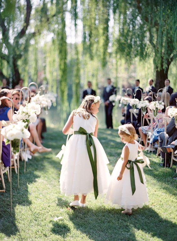 accentuate the white midi dresses with some bold sashes and bows