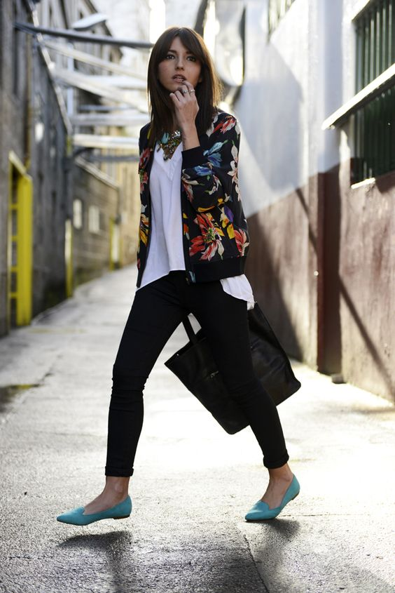black cuffed jeans, a white top, turquoise moccasins and a black floral blazer