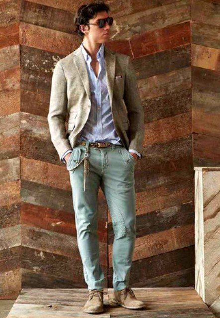 With gray blazer and beige boots