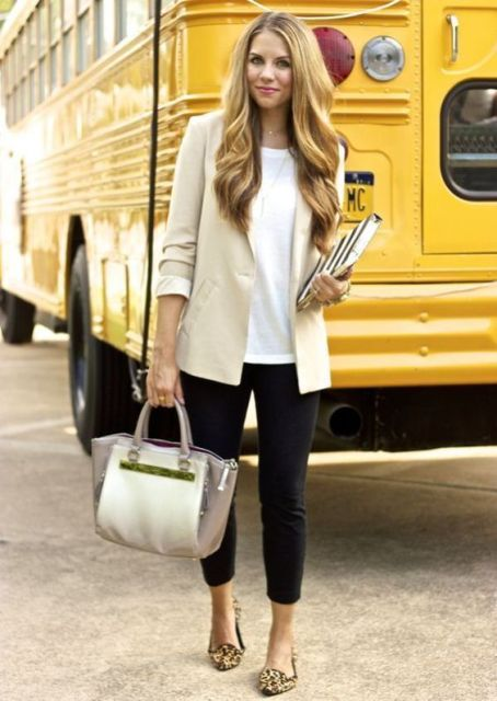 With white loose shirt, beige blazer, black crop pants and two color bag