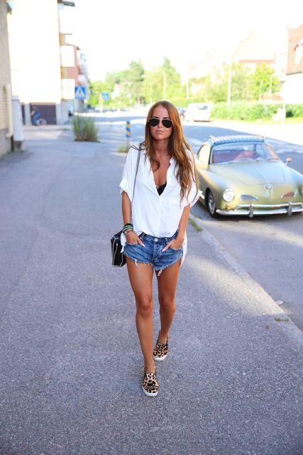 With white loose shirt, denim shorts and chain strap bag