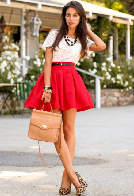 With white lace shirt, red skirt and leather bag