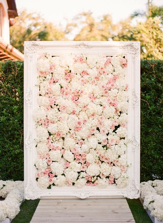 a blush and white floral framed backdrop