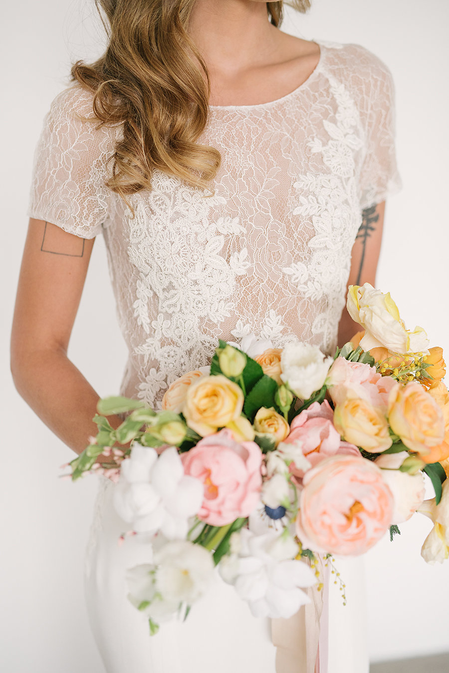 lace wedding dress details - photo by Ashlee Brooke Photography http://ruffledblog.com/summertime-citrus-wedding-inspiration