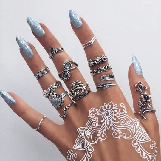 floral pattern on the hand and lots of rings