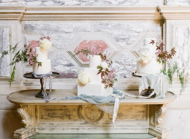 The assortment of wedding cakes was in white, with leaves and peonies