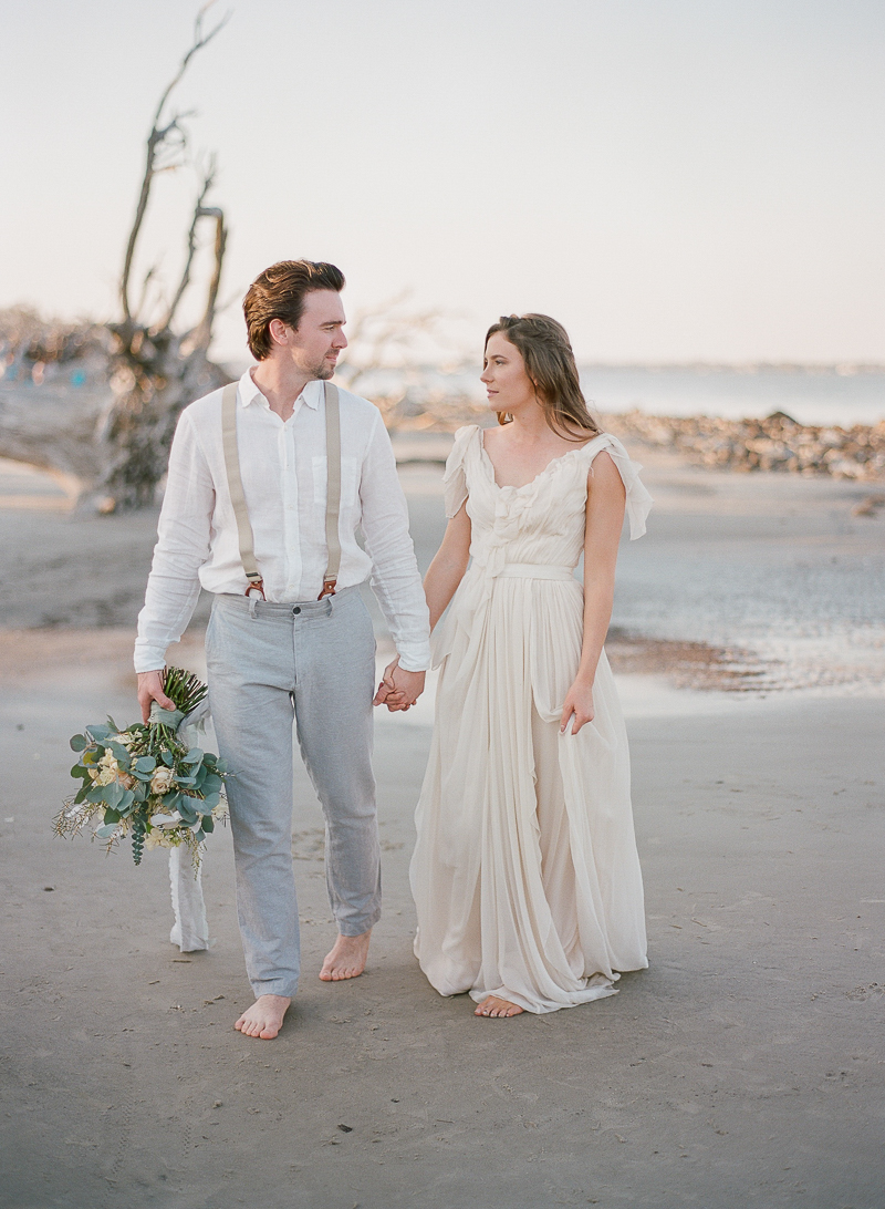 beach wedding photography - photo by The Ganeys http://ruffledblog.com/intimate-wedding-inspiration-on-driftwood-beach