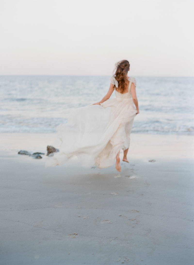 beach bridal photography - photo by The Ganeys http://ruffledblog.com/intimate-wedding-inspiration-on-driftwood-beach