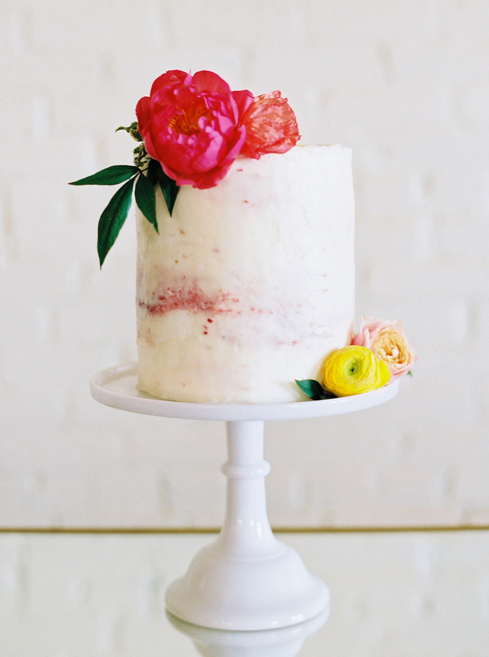 simple wedding cakes - photo by Jessica Gold Photography http://ruffledblog.com/vibrant-summer-wedding-inspiration-with-fun-colors