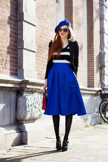 With striped shirt, black jacket, blue beret, red bag, polka dot tights and ankle boots