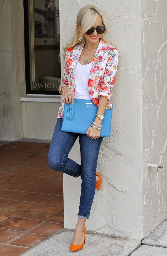 blue jeans, a white top, a bold floral blazer and orange heels