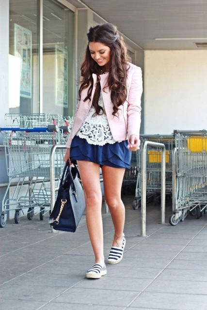 With lace shirt, navy blue skirt and black bag