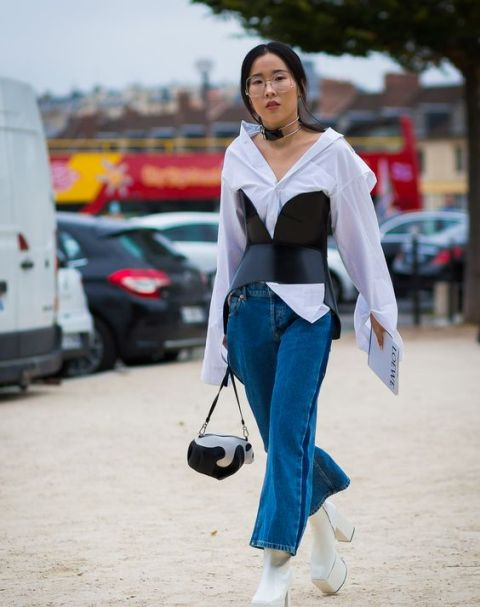 With white shirt, crop jeans, white platform boots and mini bag
