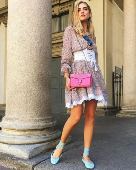 With floral dress, lace up flats and fuchsia bag