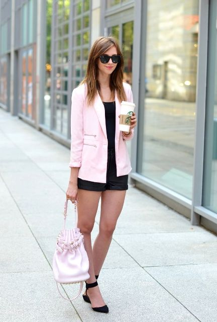 With black top, black shorts and pale pink bag