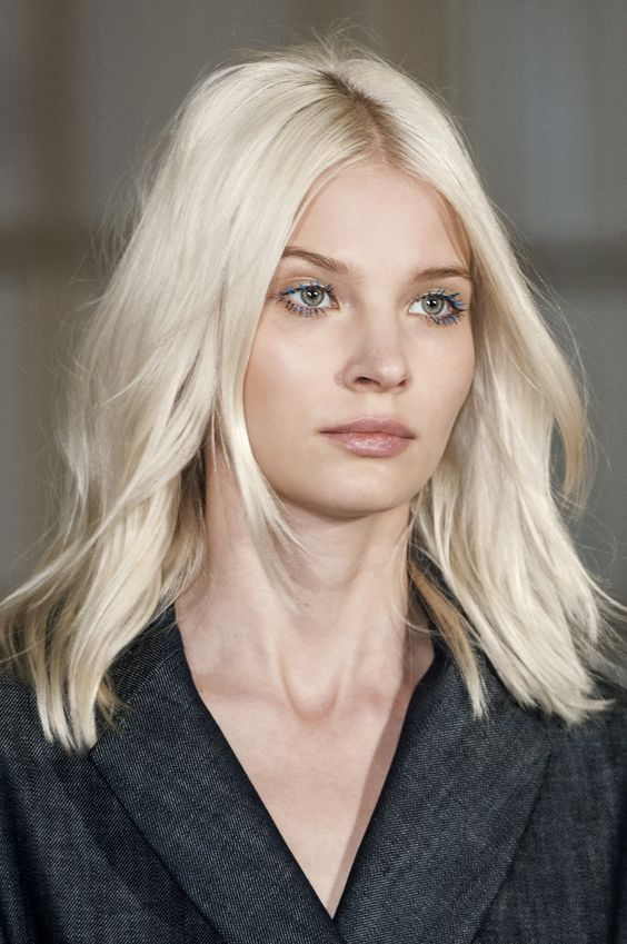 medium-length icy blonde hair with light waves