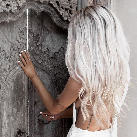 long icy blonde hair looks ideal with tanned skin and white nails