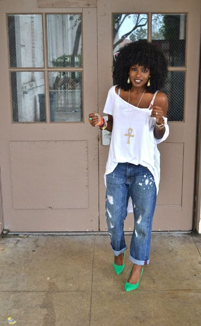 With white loose top and distressed jeans