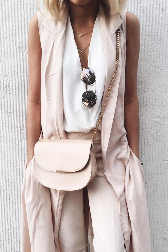 blush pants and a long vest, a white top with a V cut