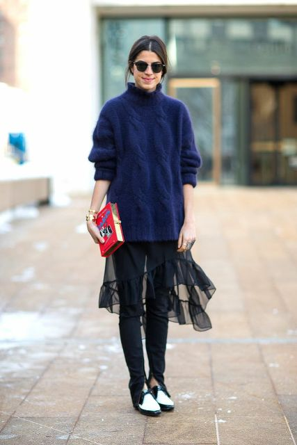 With black pants, two color shoes and sweater