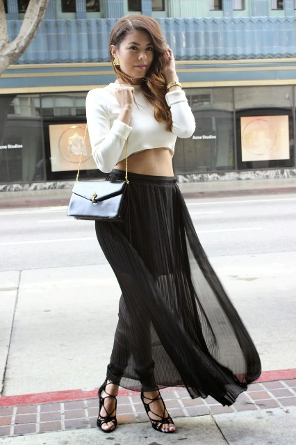 With white top, black shoes and chain strap bag