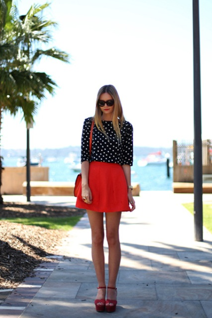 With polka dot blouse, red bag and red sandals