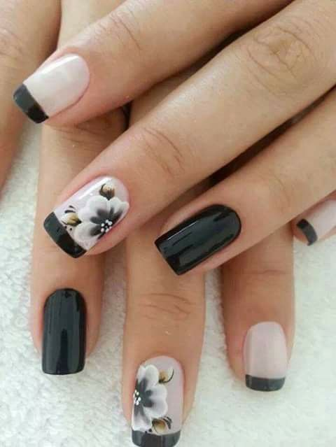 black and blush French manicure with two black nails and flowers